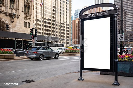 1036904778 istock photo Blank billboard at bus stop for advertising, Chicago city buildings and street background 1160520759