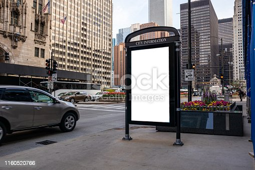 1036904778 istock photo Blank billboard at bus stop for advertising, Chicago city buildings and street background 1160520766