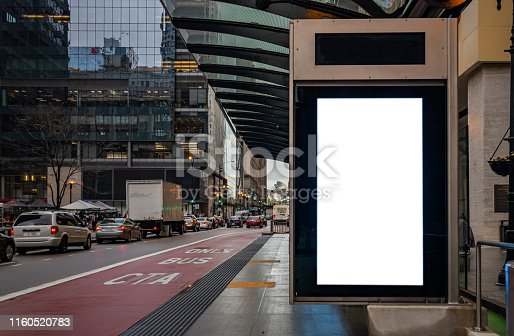 1036904778 istock photo Blank billboard at bus stop for advertising, Chicago city buildings and street background 1160520783