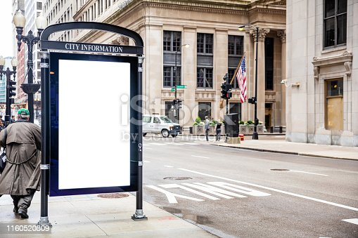 1036904778 istock photo Blank billboard at bus stop for advertising, Chicago city buildings and street background 1160520809