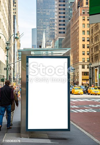 1036904778 istock photo Blank billboard at bus stop for advertising, New York city buildings and street background 1155063376