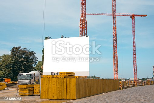 istock Blank billboard at construction site 1034388078