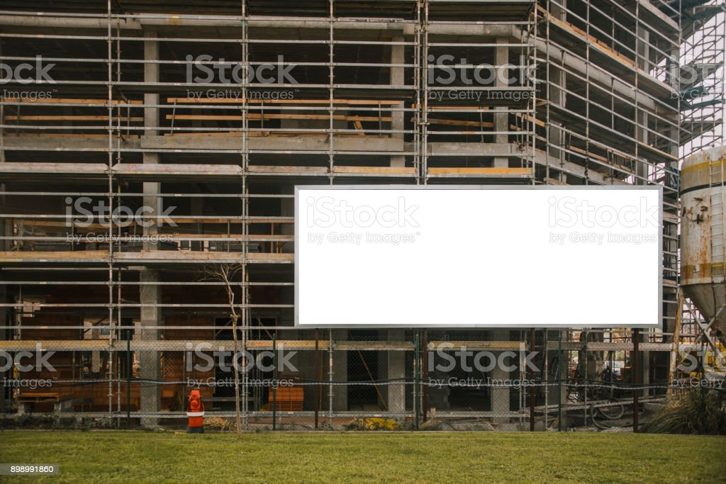 Blank billboard at construction site stock photo