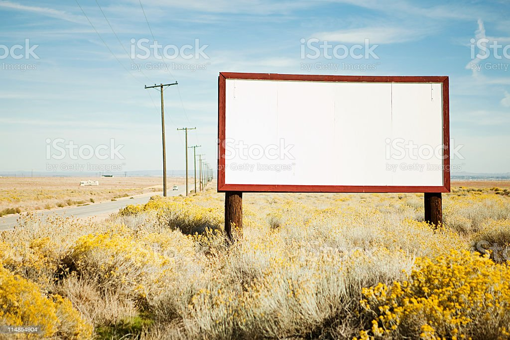 Blank billboard at roadside stock photo