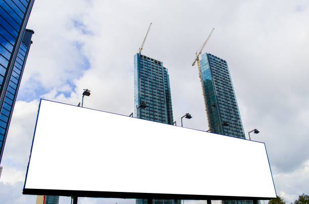 Blank billboard at skyscrapers backgound, mock up - foto stock