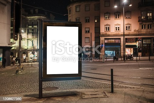 932815522 istock photo Blank billboard at street at night 1208627350