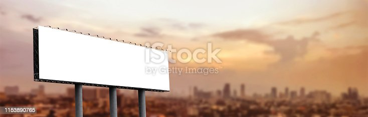 istock Blank billboard at twilight for design work 1153890765