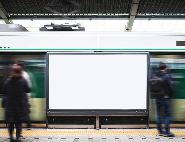 blank billboard banner in subway station with blurred people - billboard train station bildbanksfoton och bilder