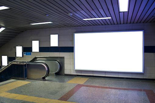istock blank billboard beside escalator in subway useful for your advertising 875292862
