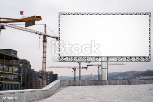 istock Blank billboard for advertisement at in the city with construction crane 687904972