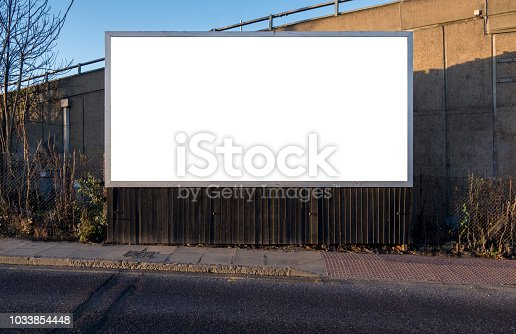 Billboard blank near road and pavement for customisation. Outdoor landscape rectangular advertising display for insertion of creative designed content