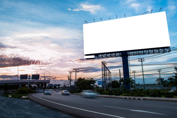 Blank billboard for outdoor advertising Blank billboard for outdoor advertising at twilight time multiple lane highway stock pictures, royalty-free photos & images
