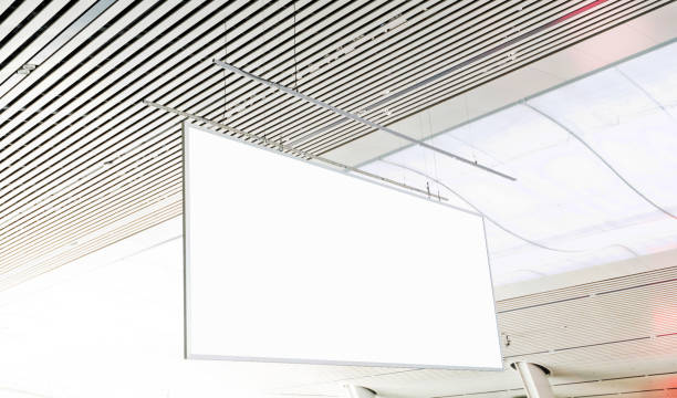 Blank billboard hanging from the ceiling Blank billboard hanging from the ceiling. electronic billboard stock pictures, royalty-free photos & images