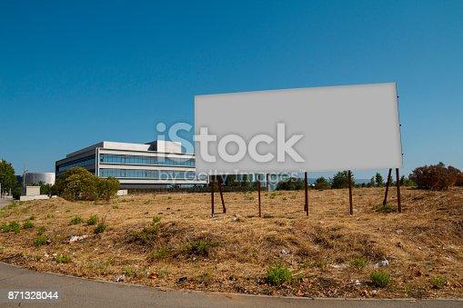 istock Blank billboard in a plot 871328044
