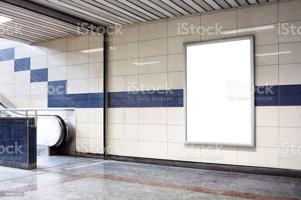 Blank billboard in a subway station wall. stock photo