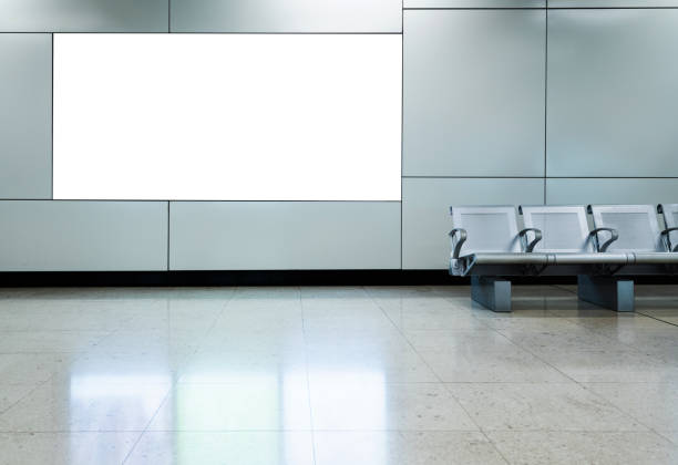 Blank billboard in airport waiting area Blank billboard in airport waiting area. electronic billboard stock pictures, royalty-free photos & images