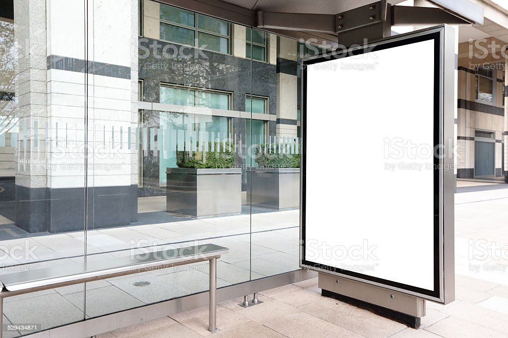 Blank billboard in bus stop stock photo