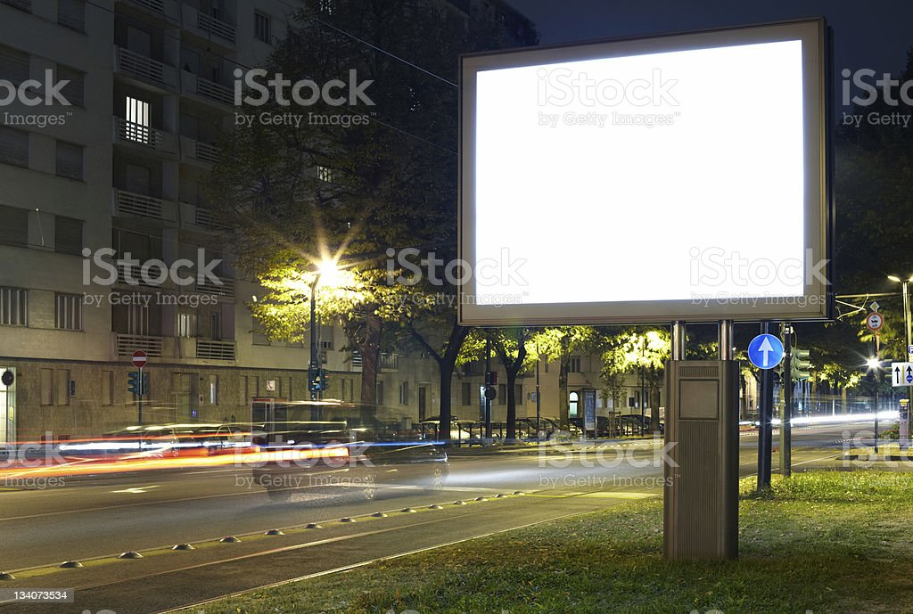 Blank billboard in city street at night royalty-free stock photo