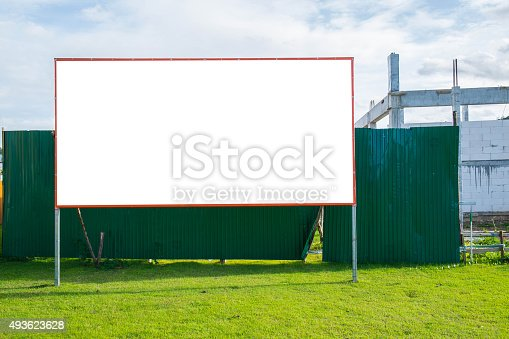 istock Blank billboard in green field and under construction site 493623628