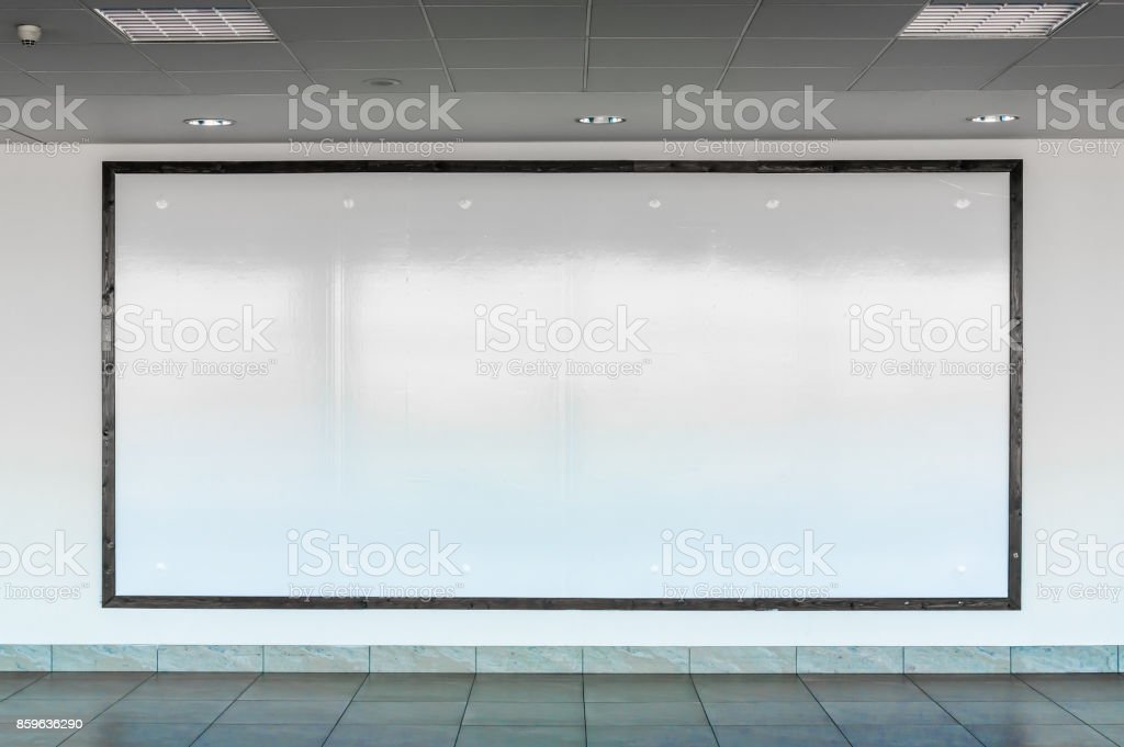 Blank billboard in interior airport hall stock photo