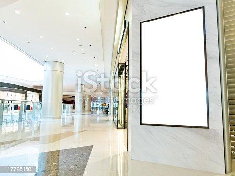 Blank billboard in modern shopping mall.