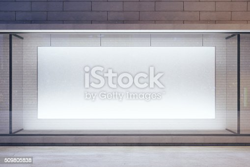 istock Blank billboard in showcase on evening street, mock up 509805838