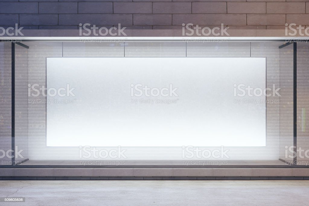 Blank billboard in showcase on evening street, mock up stock photo