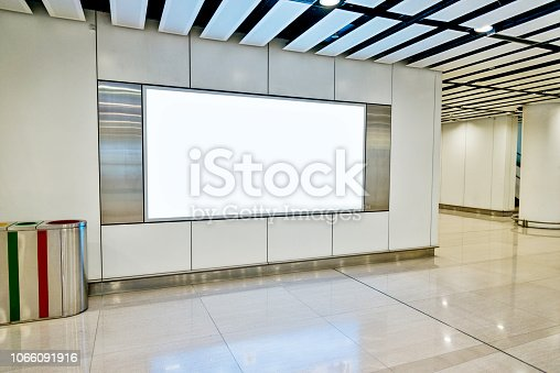 Blank billboard in subway station.