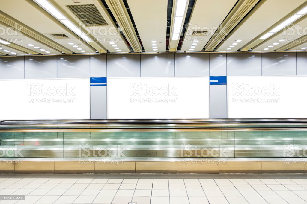 Blank billboard in the city building, shot in subway station stock photo