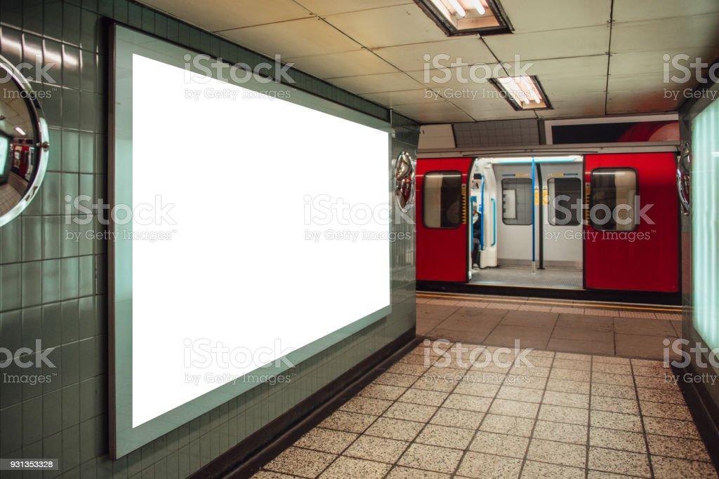 Blank billboard inside underground station - foto stock