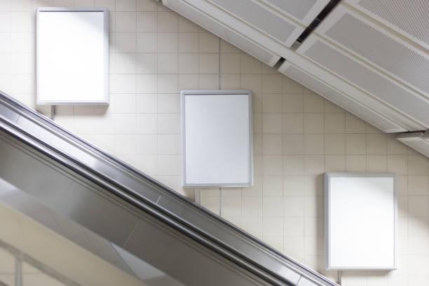 blank billboard located in subway for advertising - escalator foto e immagini stock