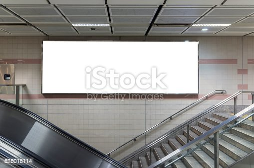 istock Blank billboard located in underground hall or subway for advertising, mockup concept, Low light speed shutter 828018114