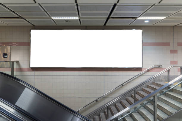 Blank billboard located in underground hall or subway for advertising, mockup concept, Low light speed shutter stock photo