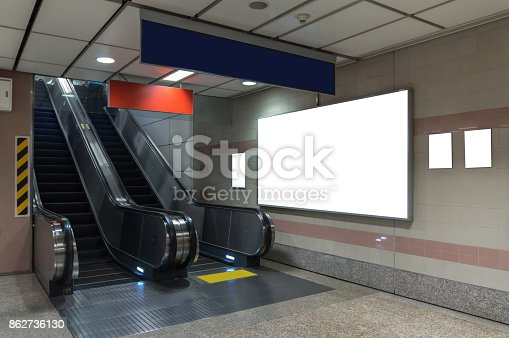 istock Blank billboard located in underground hall or subway for advertising, mockup concept, Low light speed shutter 862736130