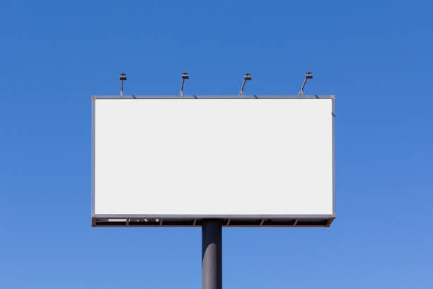 Blank billboard mock up Blank billboard mock up for advertising, against blue sky billboard stock pictures, royalty-free photos & images