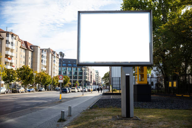 Blank billboard mockup for advertising, City street background Blank billboard mockup for advertising, City street background berlin stock pictures, royalty-free photos & images