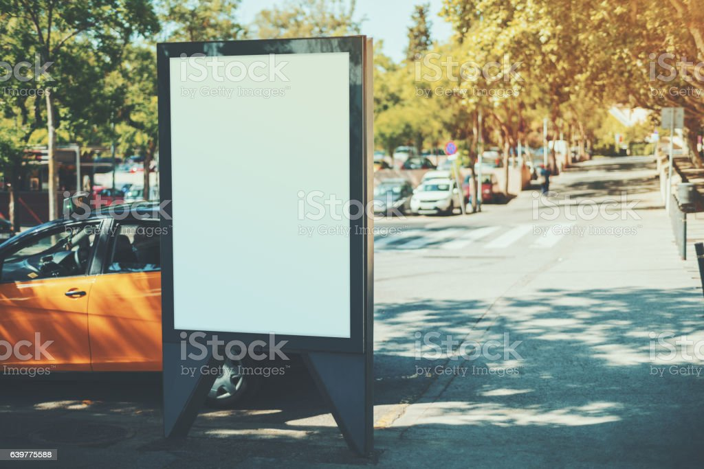 Blank billboard near yellow taxi - foto stock