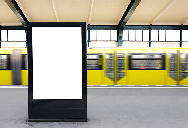 Blank Billboard on a metro station / Berlin Blank Billboard on a metro station / Berlin - Clipping path included subway platform stock pictures, royalty-free photos & images