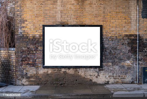 istock Blank billboard on brick wall for customisation and mockup in an urban location 1190805533