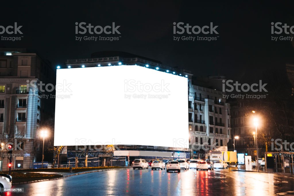 Blank billboard on building at night stock photo