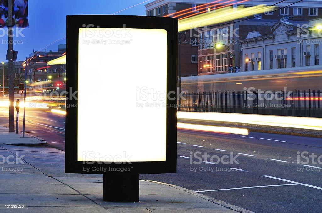 Blank Billboard on City Street at Night royalty-free stock photo