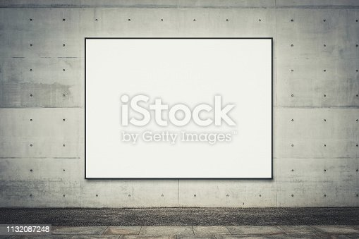 istock blank billboard on concrete wall with copy space for advertisment , banner mock up   - 1132087248