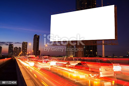 istock Blank billboard on light trails street and traffic jame, city and urban in the night - can advertisement for display or montage product or business. 861122404