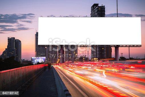 istock Blank billboard on light trails, street and urban in twiligh 640193142