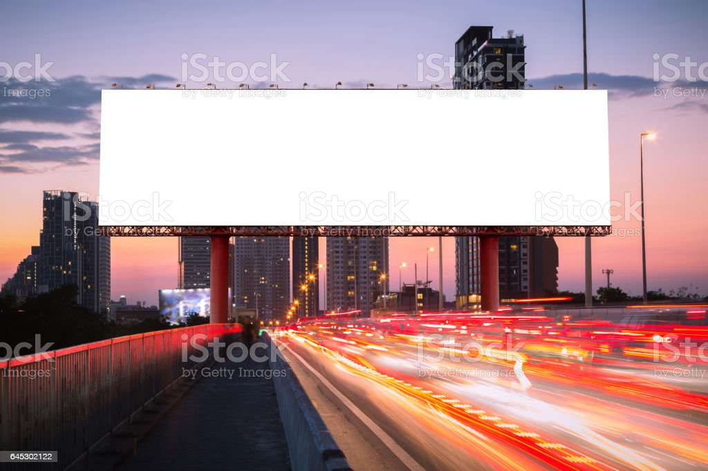 Blank billboard on light trails, street and urban stock photo