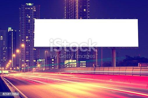 istock Blank billboard on light trails, street, urban in night 820812554