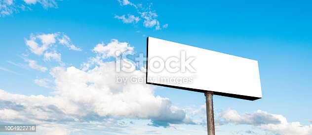 Blank billboard on sky background.