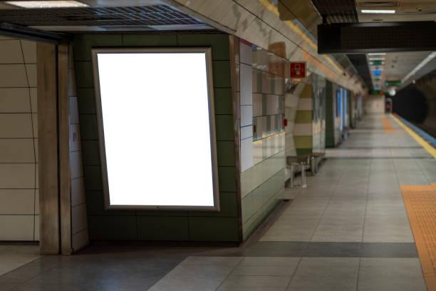 Blank billboard on the metro station. stock photo