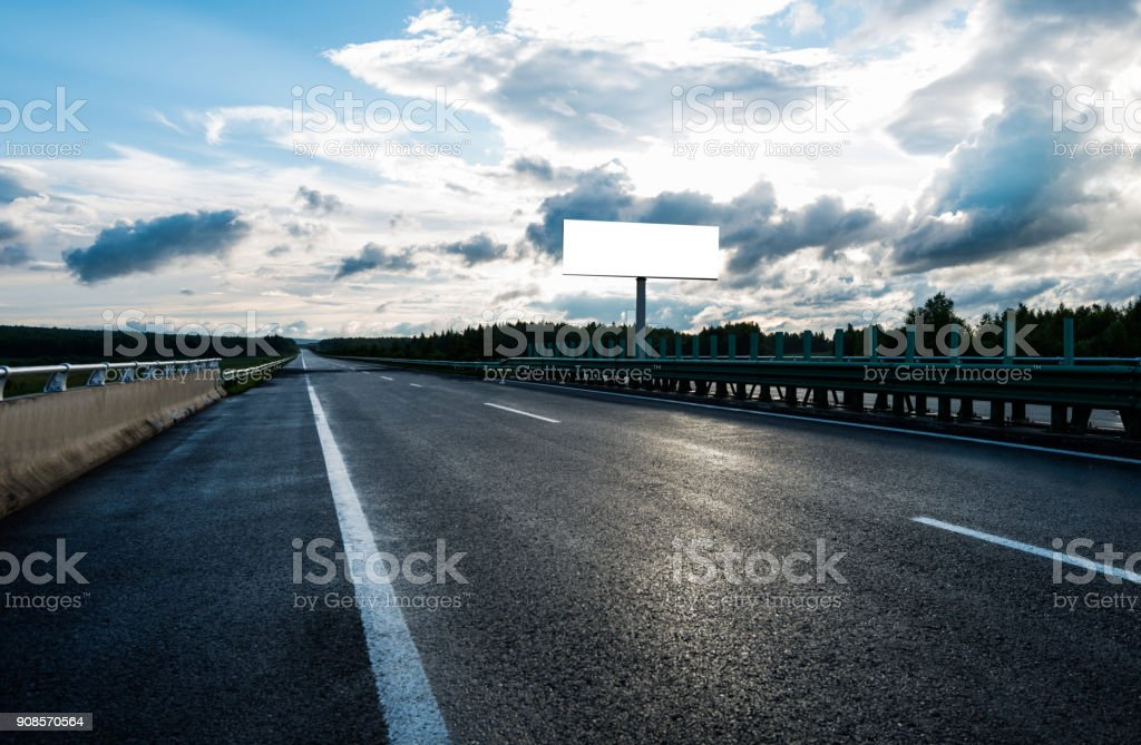 Blank billboard on the side of country road stock photo
