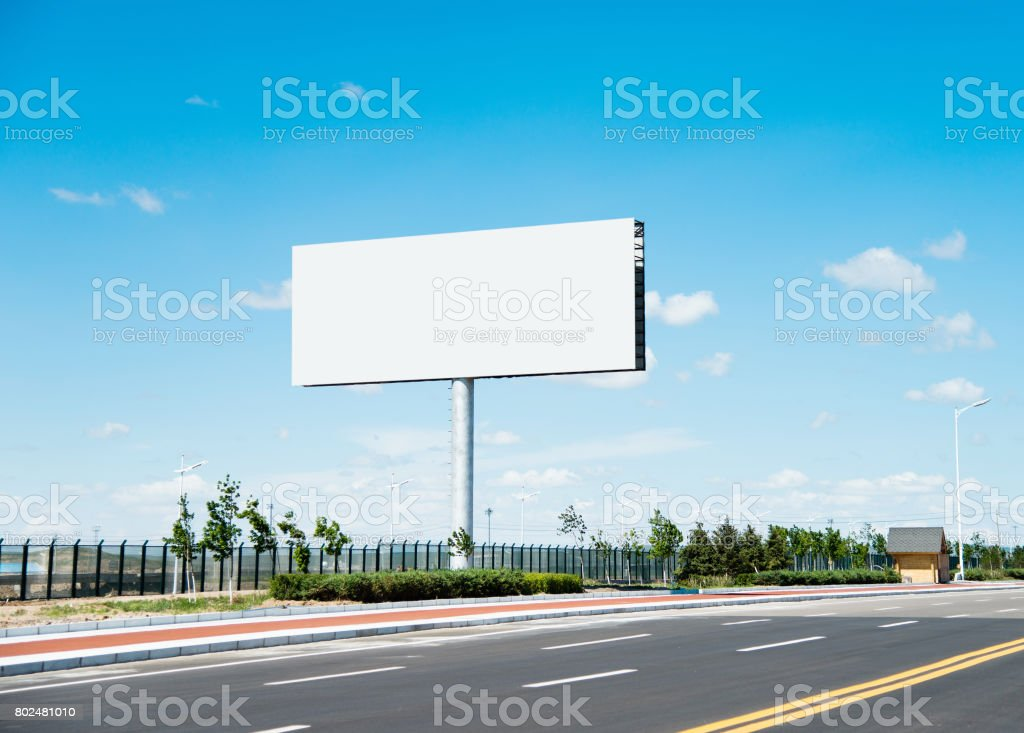 Blank billboard on the side of the road stock photo